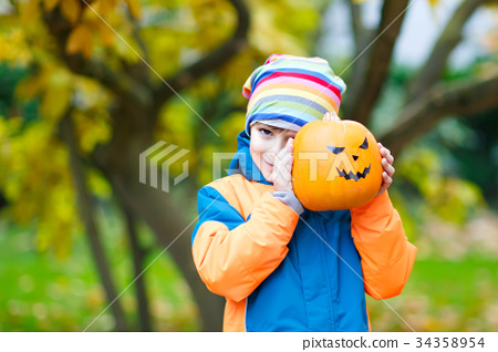 happy cute little kid boy with halloween pumpkin 34358954
