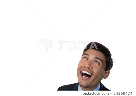 Close up of happy businessman looking up 34369474