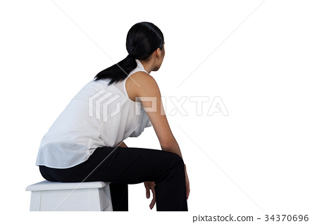 Side view of woman sitting on stool 34370696