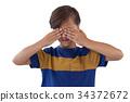 Cute boy covering his eyes 34372672