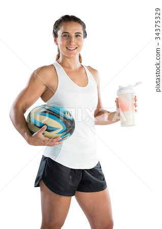 Portrait of happy female rugby player with ball and drinking bottle 34375329
