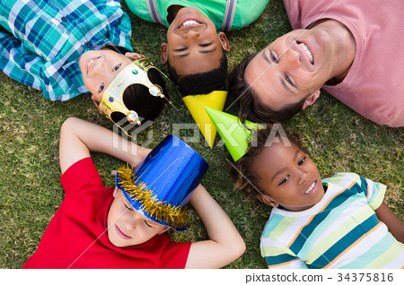 Directly above shot of man with children lying on field 34375816