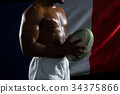 Mid section of shirtless sportsman holding rugby ball against Italian Flag 34375866