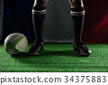 Low section of rugby player standing against Italian Flag 34375883