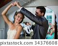 Wedding couple dancing in hall 34376608