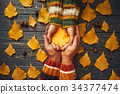 Autumn couple holding yellow ash leaf,embrace hand 34377474