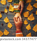 Suppurt and trust. Autumn couple embrace hand 34377477