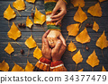 Family support. Autumn couple embrace hands 34377479