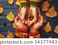 Autumn couple holding hands oak acorn top view, 34377483