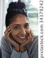 Close-up portrait of smiling woman 34379242