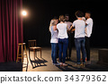 Actors team forming their hands stacked 34379362