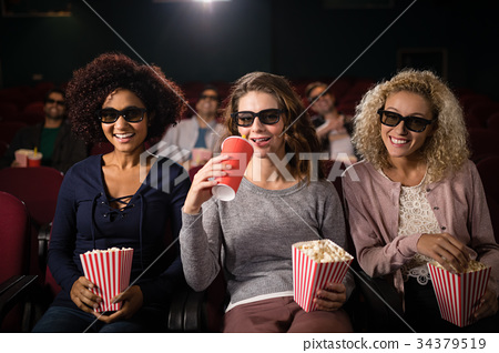 Group of people watching movie 34379519
