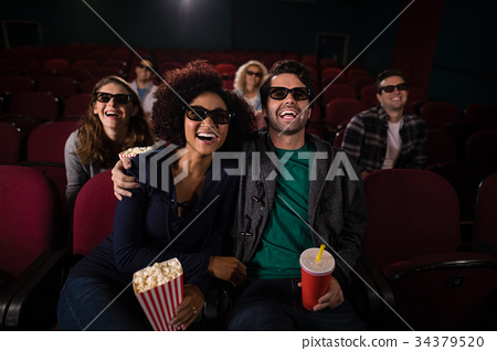 Group of people watching movie 34379520