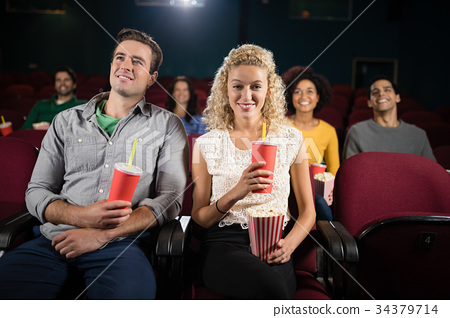 Couple watching movie in theatre 34379714