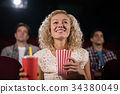 Woman watching movie in theatre 34380049