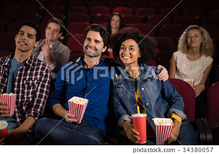 Couple watching movie in theatre 34380057