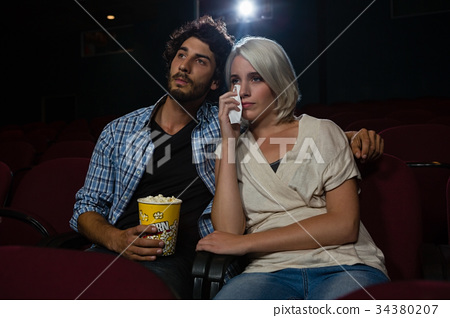 Couple getting emotional while watching movie 34380207