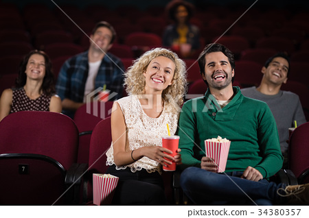 Couple watching movie in theatre 34380357