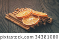 true cinnamon sticks and dried oranges 34381080