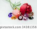 light pendant shine on the colorful gemstones. 34381356