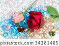 rose flowers are on the blue gemstones. 34381485