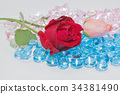 rose flowers are on the blue gemstones. 34381490