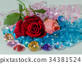 rose flowers are on the colorful gemstones. 34381524