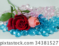 rose flowers are on the colorful gemstones. 34381527