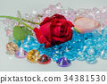 rose flowers are on the colorful gemstones. 34381530
