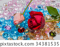 rose flowers are on the colorful gemstones. 34381535