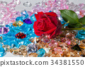 red rose flower on the colorful gemstones 34381550