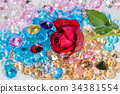 red rose flower on the colorful gemstones 34381554