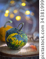 Autumn decoration with small pumpkins 34381999