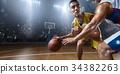 Basketball players on big professional arena 34382263