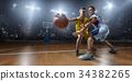 Basketball players on big professional arena 34382265