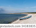 Blue rowing boat by seaside 34383835