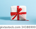Gift box with miniature Christmas trees 34386900