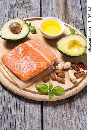 Healthy food vegetables , nuts and salmon 34394884