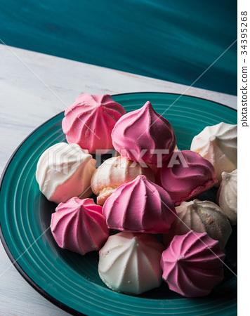 Pastel color meringue on green 34395268