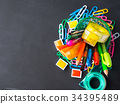Colorful stationery back to school concept on dark 34395489