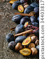 Plums and walnuts 34403817