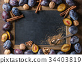 Plums and walnuts with chalkboard 34403819
