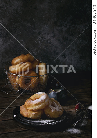 Homemade donuts with sugar powder 34403848