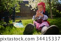 Little boy wearing pirate costume is drinking toy 34415337