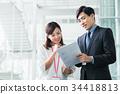 businessman business woman 34418813
