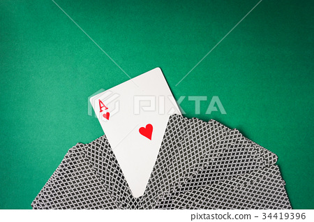 Heart ace with playing cards on green background. 34419396