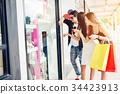 Shopping friends are walking and shopping  34423913