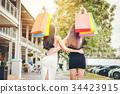 Happy women friendship Enjoying Spending shopping  34423915