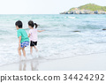 Young little girl and boy on the beach 34424292