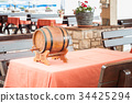 Small barrel of wine on table 34425294